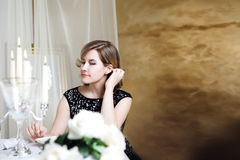 Young woman sitting at the Banquet table with Stock Photography