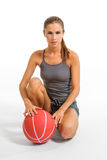 Young woman sitting with basketball Royalty Free Stock Photography
