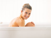 Young woman sitting in bathtub Stock Photography