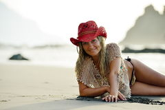 Young woman sitting on the beach Stock Photos