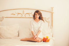 Young woman sitting at the bed Royalty Free Stock Image