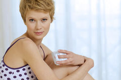 Young woman sitting in bed. Young women sitting in bed Stock Image