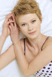 Young woman sitting in bed. Young women sitting in bed Royalty Free Stock Photography