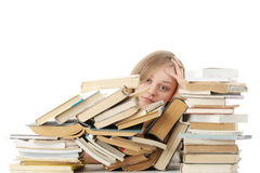 Young woman sitting behind books Stock Image