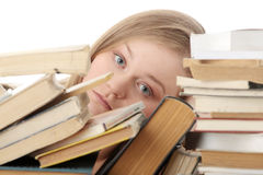 Young woman sitting behind books Royalty Free Stock Photo