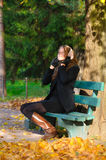 Young woman is sitting on the bench Stock Photos