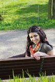 Young woman sitting on a bench Royalty Free Stock Images