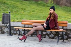 Young woman sitting on a bench. Royalty Free Stock Photo
