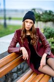 Young woman sitting on a bench. Royalty Free Stock Image