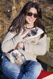 Young woman sitting on a bench hugging her dog Royalty Free Stock Image