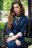 Young woman sitting on the bench in park Stock Photography