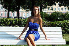 Young woman sitting on bench Royalty Free Stock Photography