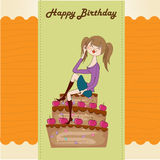 Young woman sitting on a big cake Stock Image
