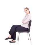 Young woman sitting on black chair Stock Photo
