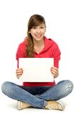 Young woman sitting with blank poster Royalty Free Stock Images