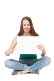 Young woman sitting with blank poster Royalty Free Stock Image