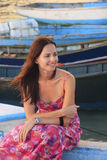 Young woman sitting at Boca Chica boat pier Stock Image