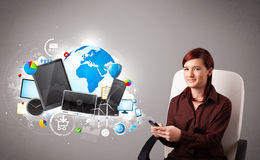Young woman sitting and browsing on her phone Royalty Free Stock Image