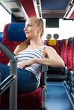 Young woman sitting on the bus Royalty Free Stock Image