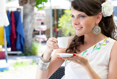 Young woman is sitting in the cafe Royalty Free Stock Images