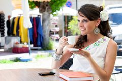 Young woman is sitting in the cafe Stock Photo