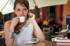 Young woman is sitting in the cafe Royalty Free Stock Image