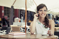 Young woman is sitting in the cafe Stock Photos