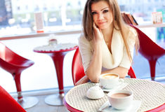 Young woman sitting in the cafe with a cup of tea Stock Photography
