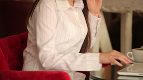 Young woman sitting at cafe and talking on the stock video