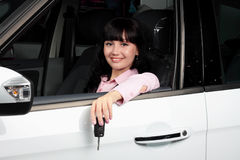 young woman sitting in a car Stock Image