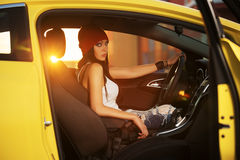 Young fashion woman driving her car Royalty Free Stock Photography