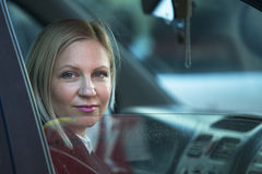 Young woman sitting in the car. Royalty Free Stock Image