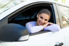 Young woman sitting in a car Stock Images