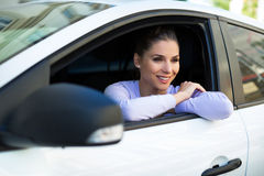 Young woman sitting in a car Royalty Free Stock Photography