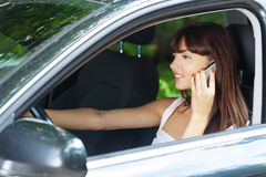 Young woman sitting car talking Stock Image