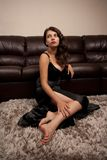 Young woman sitting on carpet indoor Royalty Free Stock Photos