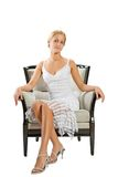 Young woman sitting on chair Royalty Free Stock Photos