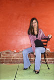 Young Woman Sitting on Chair Royalty Free Stock Photography