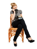 Young woman sitting on a chair Stock Photo
