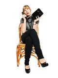Young woman sitting on a chair Royalty Free Stock Images