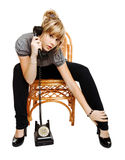 Young woman sitting on a chair Stock Photography
