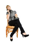 Young woman sitting on a chair Royalty Free Stock Photos