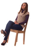 Young woman sitting on a chair. Royalty Free Stock Images