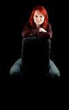 Young woman sitting on the chair Royalty Free Stock Images