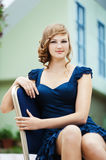 Young woman sitting chair Royalty Free Stock Image