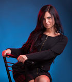 Young woman sitting on chair Stock Photography