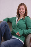 Young woman sitting in a chair Royalty Free Stock Images