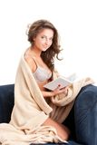 Young woman sitting on chair covered with blanket Stock Photography