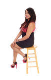 Young woman sitting on chair. Stock Photography