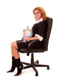 Young woman sitting in chair with globe Stock Photography